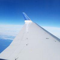 wing tip, blue sky